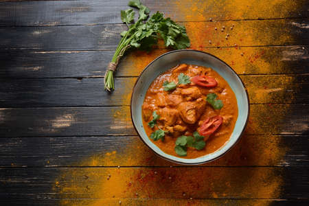 Chicken Tikka Masala- traditional Indian/ British dish. Chicken with curry, turmeric. Indean dinner concept. Asian, Indian food