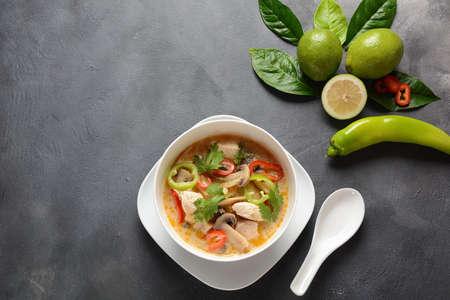 Thai style coconut milk soup-Tom Kha Gai with chicken,mushrooms, galangal, lime leaves, lemongrass, chili peppers. Thai cuisine food concept Фото со стока