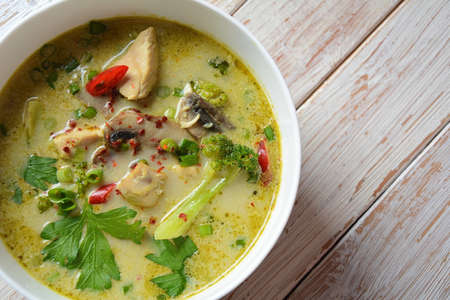Traditional Thai cuisine, Thai  Spicy Green curry chicken soup   withcoconut milk, mushrooms and broccoli. Healthy food