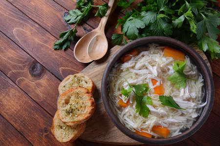 Chicken soup with noodles and vegetables in bowl. Healthy food concept