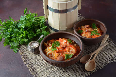 Cabbage stew with grilled sausage in tomato sauce - traditional dish of German, Polish or Russian cuisine Stock fotó