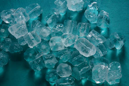Ice cubes on blue background. Copy space