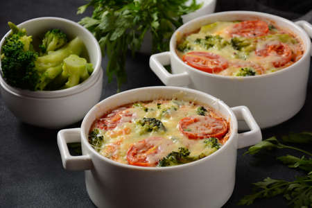 Broccoli, cheese and  egg casserole in baking cocottes