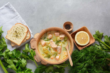 Creamy fish soup with salmon, potatoes, onions , carrots, dill and celery . Kalakeitto- traditional dish of the Finnish cuisine or Russian Ukha Fish Head Soup. Healthy Food Concept. Omega -3
