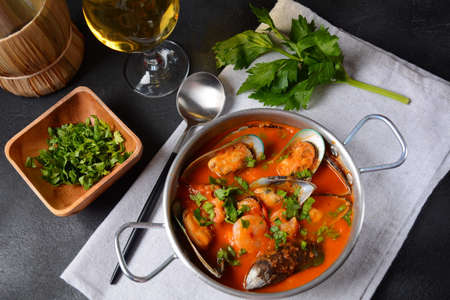French seafood bouillabaisse soup/fish stew with mussels served with garlic toast baguette Stock Photo
