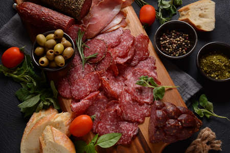 Antipasto Platter salami smoked sausage and olives with grissini bread sticks