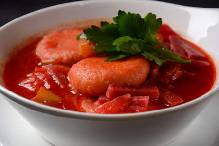 Hot red beet Kubbeh soup, a famous middle eastern dumplings soup dish, served in a bowl. A Jewish-Iraqi traditional matfuniya winter soup. Levantine dish made of bulgur, minced onions, ground beef Reklamní fotografie