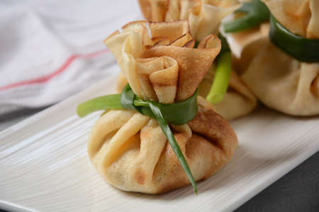 Chicken-Filled Crepe Party Purses. Pancakes rolled into a bag and stuffed with chicken meat