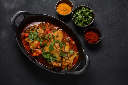 Moroccan fish with chermoula, red peppers and preserved lemon. Spicy traditional Moroccan food