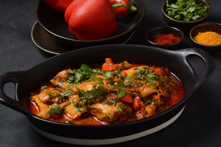 Moroccan fish with chermoula, red peppers and preserved lemon. Spicy traditional Moroccan food Stockfoto