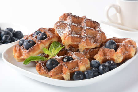 Traditional belgian waffles with fresh fruit or american waffles delicious sweet dish, dessert snack menu concept