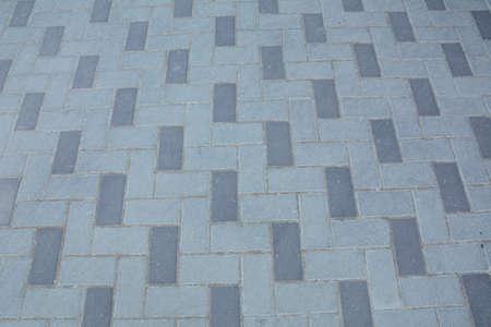 Stone pavement texture. Granite cobblestoned pavement background. Gray brick stone background.