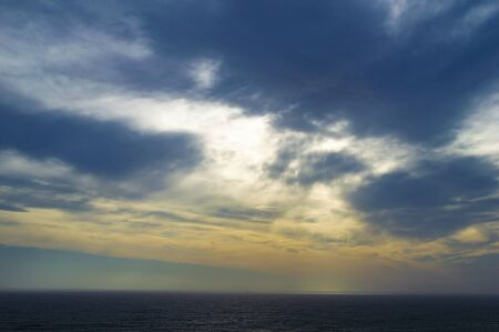 A dramatic cloudy sunset over Ligurian Sea, as seen from Lighthouse of Genoa (Lanterna di Genova) Archivio Fotografico