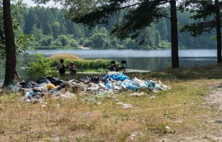 decompose: Garbage waste in the woods by the lake 12.6.16. Russia river Nerscay Stock Photo