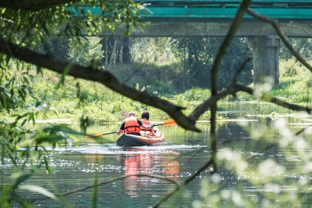 paddler: The river in the summer and a kayak paddler behind Russia 06.13.16 Nerskaya River Stock Photo