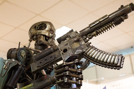 Robot (metal) assassin with automatic weapon