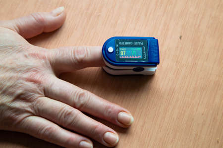 pulsoxymeter on the finger of the hand