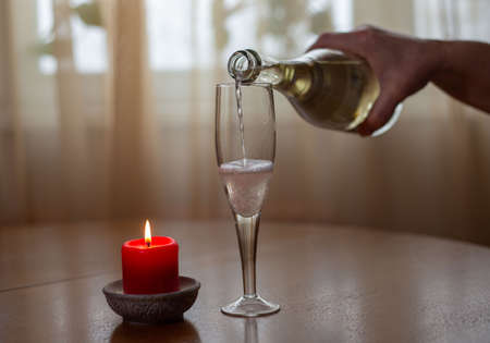 white sparkling wine poured from bottle to glass