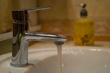 Nikiler tap with open water and chewy liquid soap 写真素材