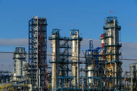 Corps of Moscow refinery in spring in clear weather 写真素材