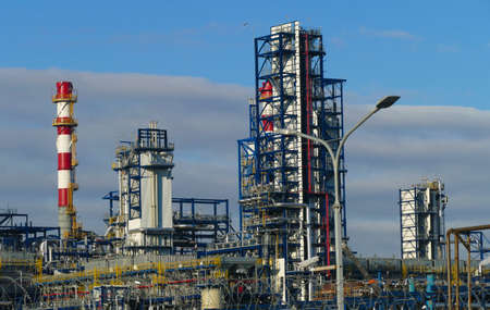 Corps of Moscow refinery in spring in clear weather Standard-Bild