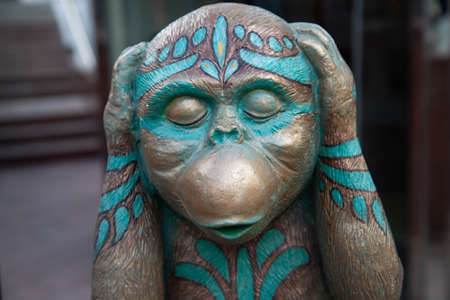 The monkey that covered his ears