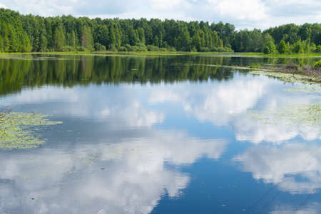 Reflection of the sky in the lake in summer