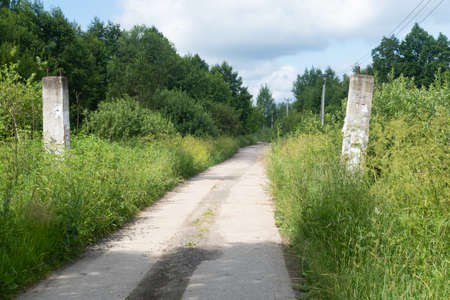 The gate is destroyed and the road to the forest