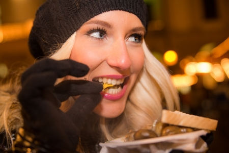 Blonde girl on the Christmas Market photo