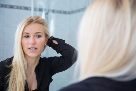 Woman mirroring herself