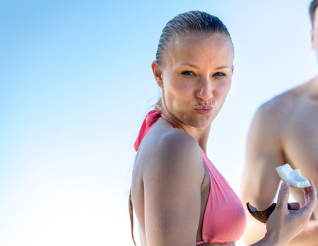 sixpack: Bikini girl eats a coconut Stock Photo