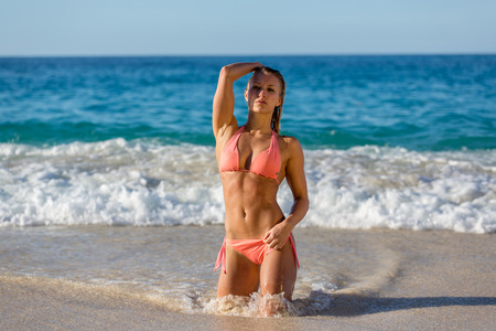 sixpack: Sexy Woman posing at the beach