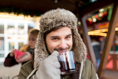 new year s day: Man smiles and has some mullet wine