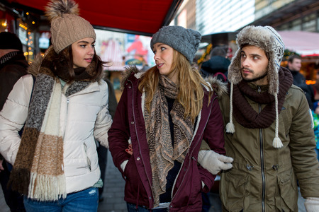 hogmanay: Couple and Friends talk to eachother at the Christmas Market Stock Photo