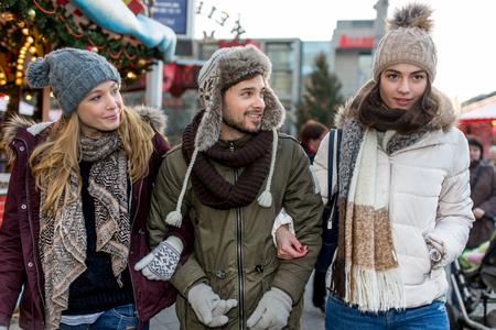 e market: Two girls and a boy walkover e christmas market