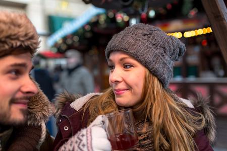 hogmanay: Couple man woman talks on the Christmas Market