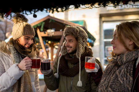 hogmanay: Couple and Friends enjoy a day at the christmas market