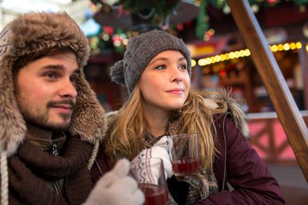 hogmanay: Couple enjoy mullet wine on the Christmas Market in Winter Stock Photo