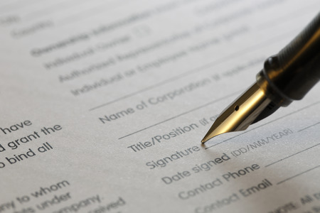signing authority: contract series, shot with very shallow depth of field Stock Photo