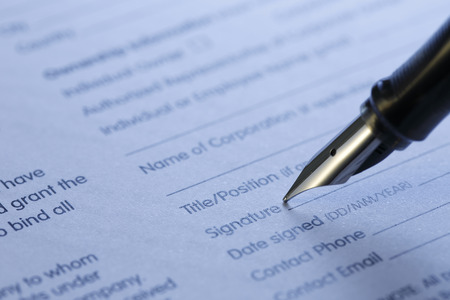 signing authority: contract series, shot with very shallow depth of field, blue tone