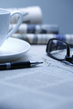 financial figures: Black pen with financial figures and Glasses,shot with very shallow depth of field.blue tone,