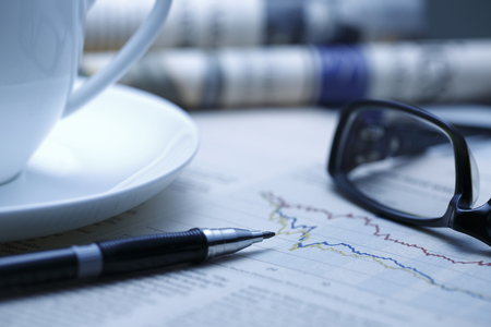blue tone: Black pen with financial figures and Glasses,shot with very shallow depth of field. blue tone, Stock Photo