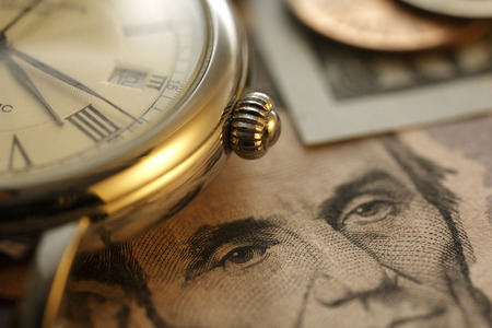 managing money: Time is money.  Gold Tone. Close up Stock Photo