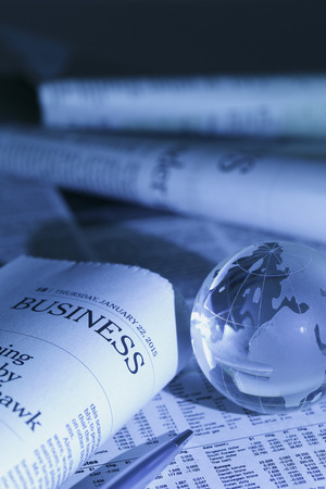 glass paper: Global finance,shot with very shallow depth of field, blue toned .
