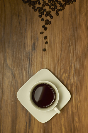 vertica: coffee cup and coffee beans on table