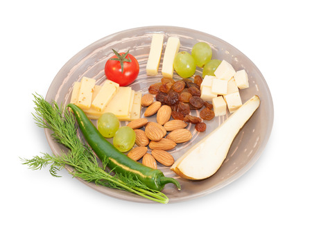 cheese plate: Brown cheese plate with almonds, fennel, olives, red peppers, cherry tomatoes, mint leaves isolated on white background