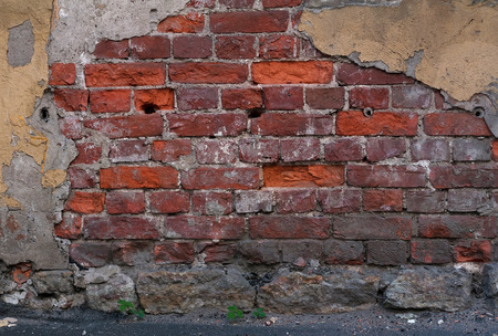 crumbling: Fragment of old brick wall with crumbling plaster