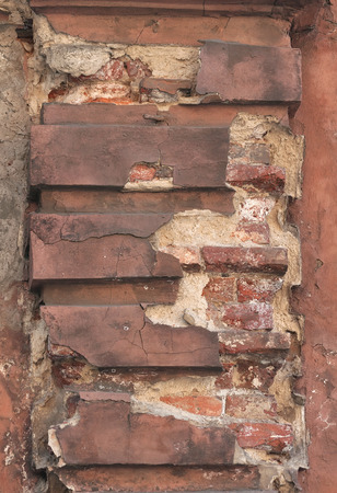 crumbling: Fragment of old wall with decorative detail crumbling plaster Stock Photo