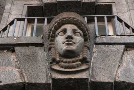 heads old building facade: Decorative feature ancient building in the form of a female head of granite Stock Photo