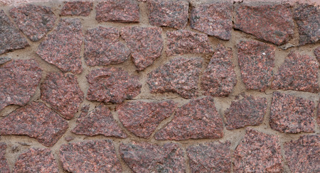 interspersed: Texture of wall interspersed with large fragments granite Stock Photo